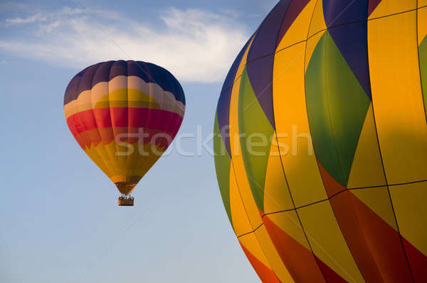 Airborne hot-air balloon with another in foreground Stock photo © Balefire9
