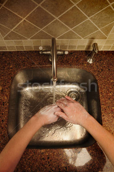 Overview of hand washing over a stainless steel sink Stock photo © Balefire9