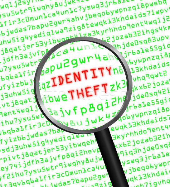 Stock photo: Identity Theft revealed in computer code through a magnifying gl