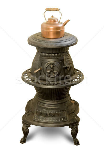 Antique iron wood-burning stove with copper kettle Stock photo © Balefire9