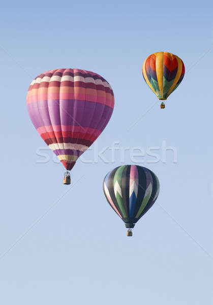 Three Hot-Air Balloons Floating against a Blue Sky Stock photo © Balefire9
