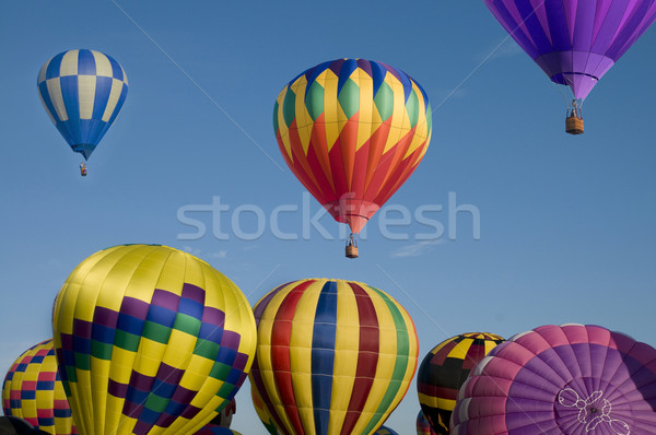 Hot-air balloon ascending over others Stock photo © Balefire9
