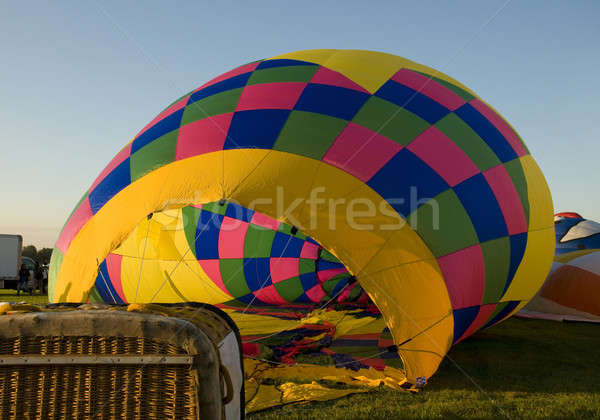 Stock photo: The envelope of a hot air balloon being inflated on the ground