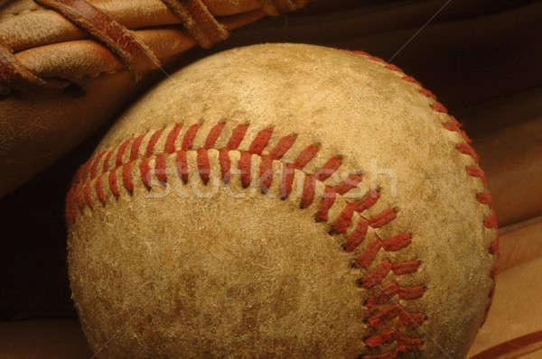 Old well-worn Baseball in a glove. Stock photo © Balefire9