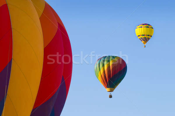 Airborne hot-air balloons with one in foreground Stock photo © Balefire9