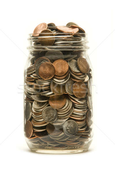 Glass jar overflowing with American coins Stock photo © Balefire9