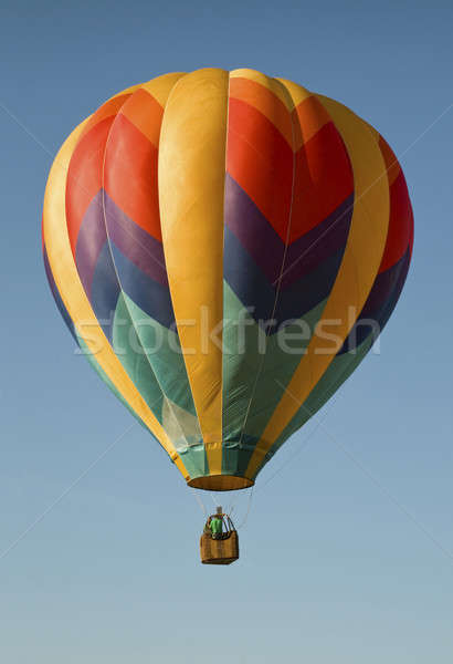 Hot-air balloon floating in a blue sky Stock photo © Balefire9