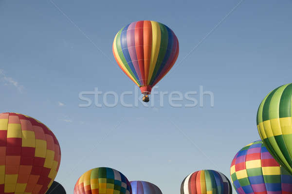 Single hot-air balloon floating above a balloon festival Stock photo © Balefire9