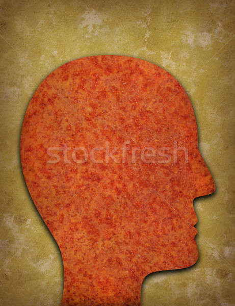Stock photo: Rusty head silhouette against yellowed background