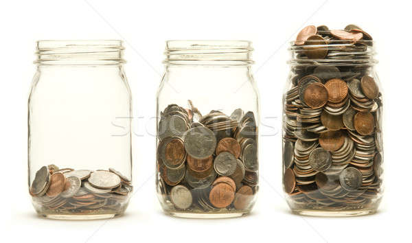 Three glass jars holding coins Stock photo © Balefire9