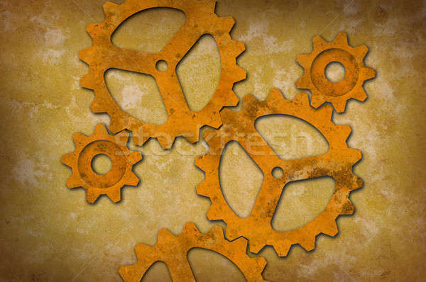 Rusty gears against a mottled yellowish background Stock photo © Balefire9