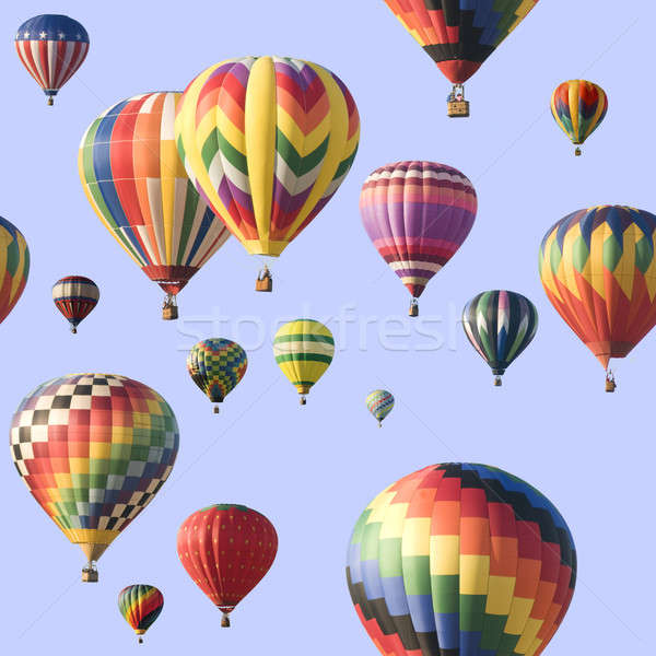 A group of colorful hot-air balloons floating across a blue sky Stock photo © Balefire9