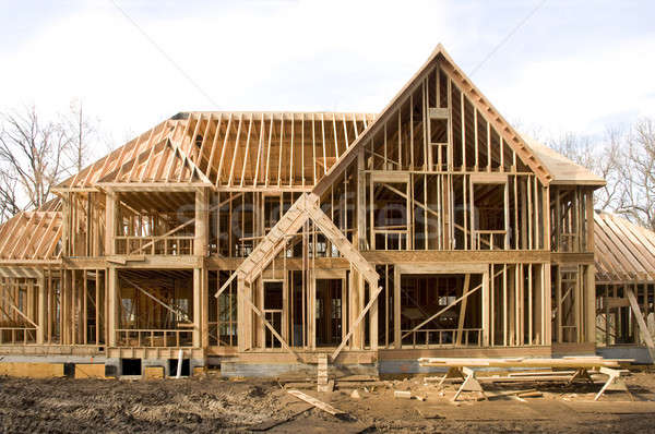 McMansion type house under construction in framing phase Stock photo © Balefire9