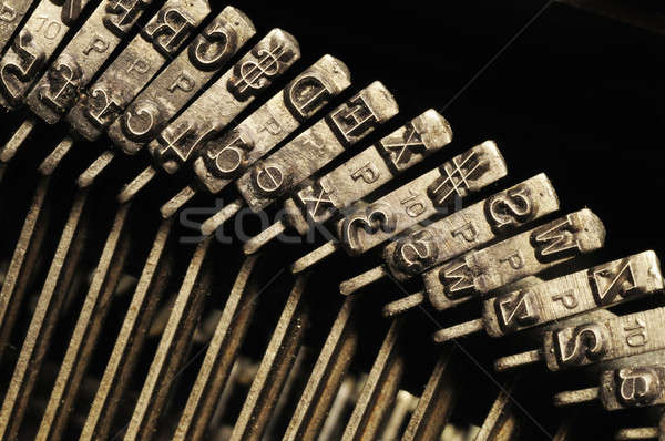 Stock photo: Close-up of old typewriter letter and symbol keys