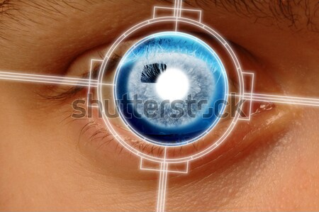 Man viewing a retinal eye scan on a video monitor Stock photo © Balefire9