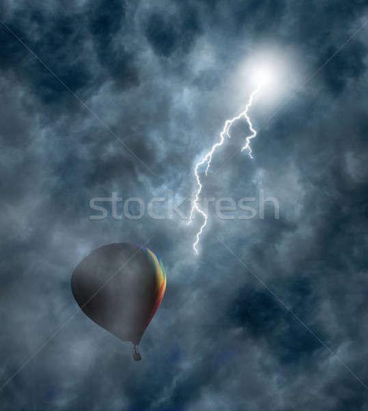Hot-Air Balloon Among Dark Storm Clouds with Lightning Stock photo © Balefire9
