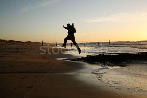 Scoprire acqua uomo felice tramonto bag Foto d'archivio © Bananna