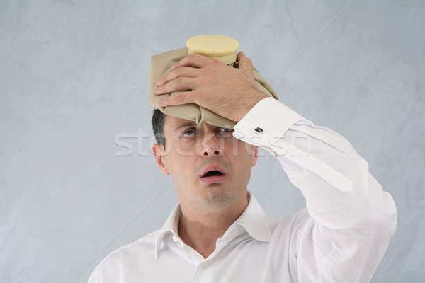man with ice pack Stock photo © Bananna