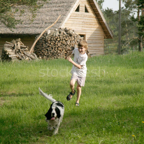 boy running with dog Stock photo © Bananna