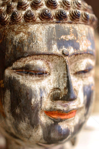 Colorful gilded face of Buddha smiling Stock photo © Bananna