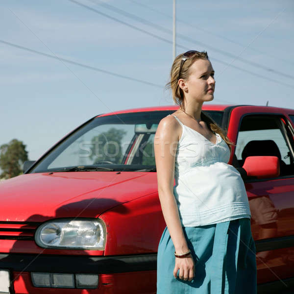 беременная женщина автомобилей Постоянный красный небе девушки Сток-фото © Bananna