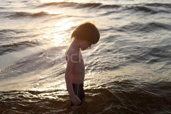 профиль кавказский мальчика морем волны закат Сток-фото © Bananna