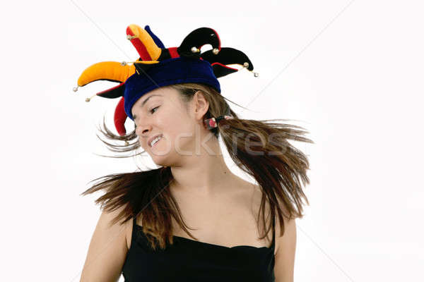 young woman in funky joker hat Stock photo © Bananna