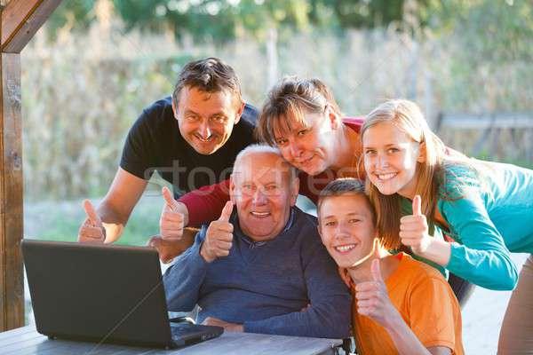 Family thumbs up Stock photo © barabasa