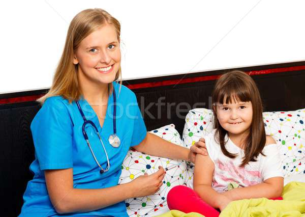 Brave Little Patient Receiving Vaccine Stock photo © barabasa