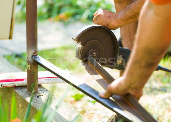 Working on fence with angle grinder Stock photo © barabasa