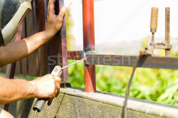 Stock photo:  Manual repairman with busy work