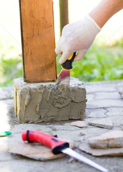 With glue will fix stones well Stock photo © barabasa
