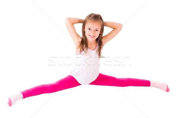 Little Girl Doing Splits Stock photo © barabasa