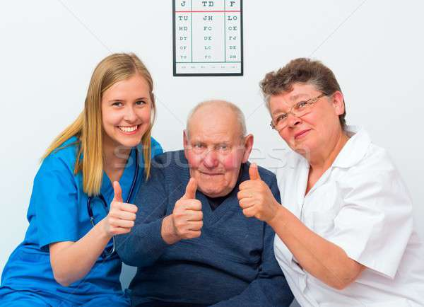 Stock photo: Thumbs Up From Elderly Man And His Caregivers