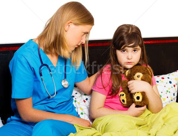 Pediatrician Supporting Sick Little Patient Stock photo © barabasa