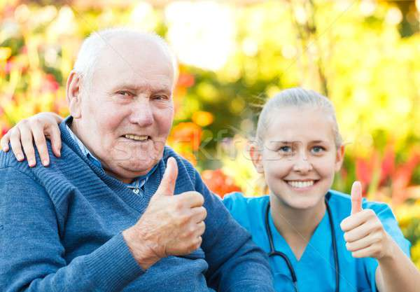 Thumbs up for nursing homes Stock photo © barabasa