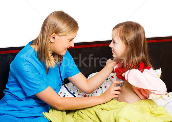 Little Girl Being Examined By Pediatrician Stock photo © barabasa