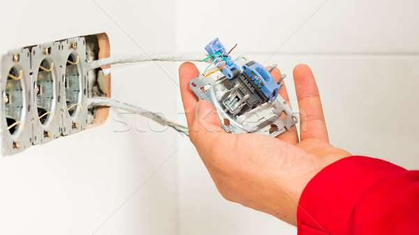 Electrician Mounting Electrical Wall Outlet Stock photo © barabasa