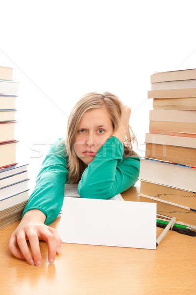 Young student has got bored of studying.  Stock photo © barabasa