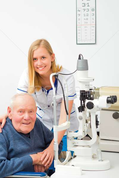 Senior Man with Glaucoma at the Ophthalmology Stock photo © barabasa