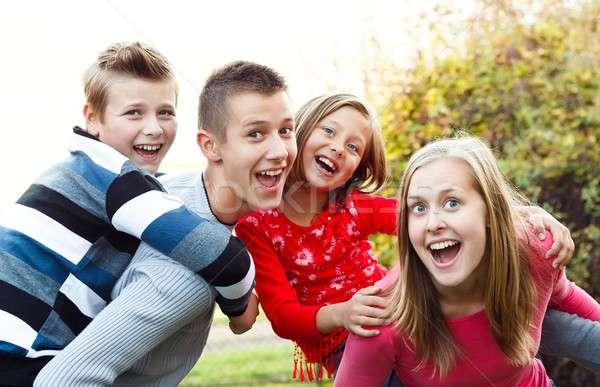 Paar kinderen mooie babysitter vrouw Stockfoto © barabasa