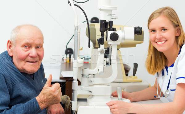 Contented Elderly Patient at the Optician's Stock photo © barabasa