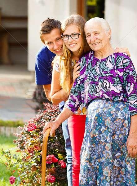 Caring Grandchildren Stock photo © barabasa