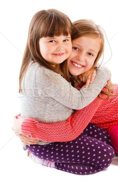 Szeretet imádnivaló kicsi nővérek mutat egyéb Stock fotó © barabasa