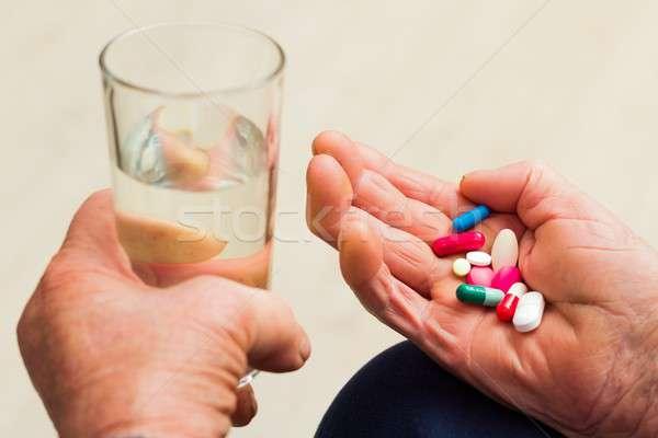 Idős egészség aggkor elvesz néhány gyógyszer Stock fotó © barabasa