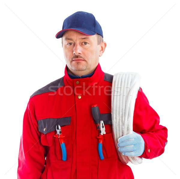 Confiável eletricista bonito flexível tubo rolar Foto stock © barabasa
