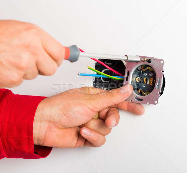 Assembling Electrical Wall Socket Stock photo © barabasa