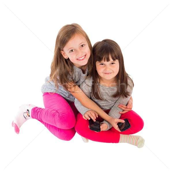 Smartphones crianças moderno tecnologia gerações família Foto stock © barabasa