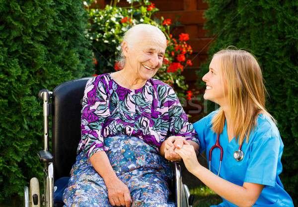 Caring for the Elderly in Wheelchair Stock photo © barabasa