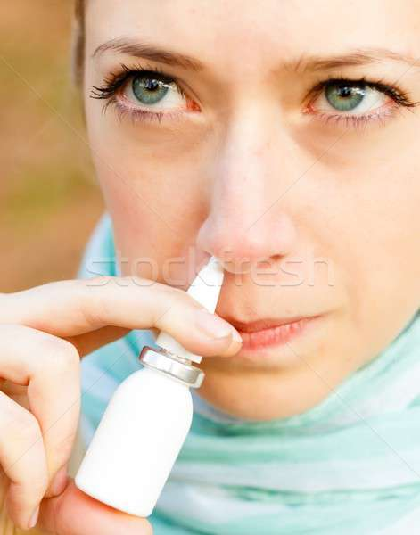 Snuffing nasal spray Stock photo © barabasa